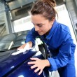 Student working on car in repairshop — Stockfoto