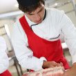 Stock Photo: Butcher preparing roast