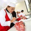 Stock Photo: Students in butchery training course