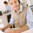Consultant on the phone with headset — Stock Photo