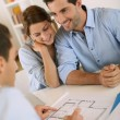 Couple meeting architect for future house — Stock Photo