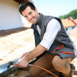 Roofer working on house roof to fix gutter — Stock Photo