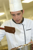 Student making cake — Stock Photo