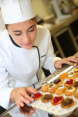 Pastry cook holding tray of pastries — Stock Photo