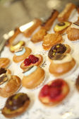 Delicious French pastries on tray — Stock Photo