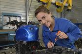 Student girl in motorbike mechanics — Stock Photo