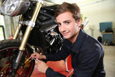 Teenager repairing motorbike — Photo