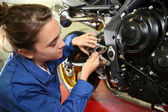 Student girl in motorbike mechanics — Stock Photo
