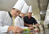 Chefs preparing delicatessen dishes — Stock Photo