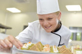 Caterer preparing tray of appetizers — Stock Photo