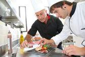 Student in catering to prepare foie gras dish — Stok fotoğraf