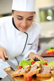 Caterer preparing food tray — Stock Photo