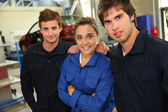 Students in coachbuidling standing in garage — Stock Photo