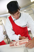 Butcher preparing roast — Stock Photo