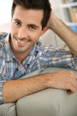 Guy relaxing at home — Stock Photo