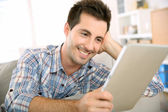 Guy using tablet to read mail — Stock Photo