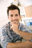 Handsome guy relaxing at home — Stock Photo