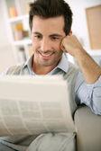 Man reading newspaper — Stock Photo