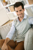 Man relaxing in sofa at home — Stock Photo