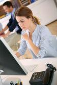 Woman working on desktop — Stock Photo