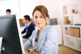Cheerful girl in office — Stock Photo