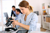 Photo reporter working in office — Stock Photo