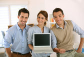 People showing laptop screen — Stock Photo
