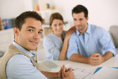 Financial adviser with young couple — Stock Photo