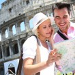 Tourists in front of the Coliseum — Stock Photo