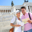 Couple near monument of Victor Emmanuel II — Stock Photo #35300187