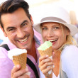 Couple eating ice cream cones — Stock Photo #35300261