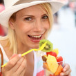 Girl eating fresh fruits — Stock Photo