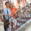 Tourists standing on a bridge in Venice — Stock Photo