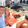 Couple on a Gondola ride passing by Rialto bridge — Stock Photo