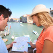 Couple looking at map on the Academia Bridge — Stock Photo