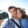 Couple taking picture of themselves — Stock Photo #35304217