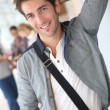 Young man in school hallway — Stock Photo