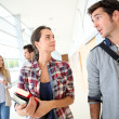 Students walking in college hallway — Stock Photo