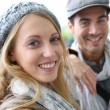 Young couple wearing hat in fall season — Stock Photo