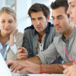 Young people working together in office — Stock Photo #35305497