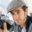 Photographer using old-fashioned camera — Stock Photo
