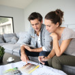 Couple searching ideas to decorate new home — Stock Photo #35306141
