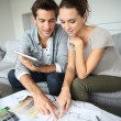 Couple searching ideas to decorate new home — Stock Photo #35306143