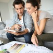 Couple searching ideas to decorate new home — Stock Photo
