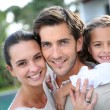 Couple with little girl — Stock Photo