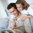 Man with daughter playing with digital tablet — Stock Photo