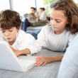 Kids playing with laptop computer — Stock Photo