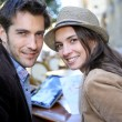 Tourists sitting at coffee shop table — Stock Photo