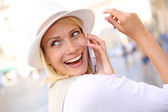 Woman with hat talking on the phone — Stock Photo