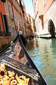 Gondole riding on water in Venice canal — Stock Photo